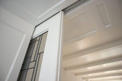 Zwevende en suite schuifdeur met bovenrails